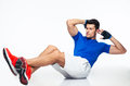 Sports man doing abdominal exercises Royalty Free Stock Photo