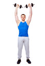 Sports man doing exercises with dumbbells Royalty Free Stock Photo