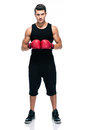Sports man with red boxing gloves full length portrait of a isolated on a white background Royalty Free Stock Images