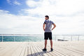 Sports man standing near sea outdoors Royalty Free Stock Photo