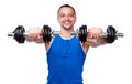 Sports man working out with dumbbells smiling on white background Royalty Free Stock Photography