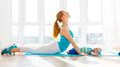 Sports mother is engaged in fitness and yoga with baby at home Royalty Free Stock Photo