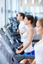 Sports people on treadmills Royalty Free Stock Photography