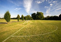 Sports pitch a and the goal zone under blue skies Stock Photography