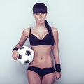 Sports sensual girl with ball Royalty Free Stock Images