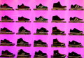 Sports shoes shelves with branded on pink background Stock Photo