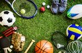 Sports tools balls shoes ground Royalty Free Stock Photo