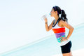 Sports woman drinking water from a bottle outdoors Royalty Free Stock Photography