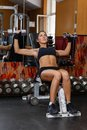 Sports woman in the gym young doing exercises with dumbbells fitness Royalty Free Stock Photo