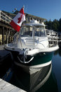 Sports yacht in Canada with Flag in beautiful suns Royalty Free Stock Photos
