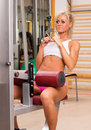 Sports young woman doing exercises on trainer back machine in gym Stock Photos