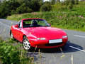 Sportscar in the country red mazda mx on a road Royalty Free Stock Photos