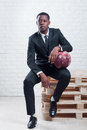 Sportsman with a ball wearing business suit Royalty Free Stock Photo