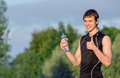 Sportsman with bottle of water gesturing ok Stock Images