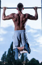 Sportsman dangling on rod in a park gym Stock Photography