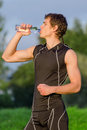 Sportsman drinking water from bottle after workout Royalty Free Stock Photos