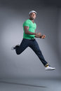 Sportsman isolated portrait of a cool jumping over a grey background Royalty Free Stock Image