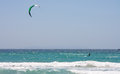 Sportsman kite surfer on clean beach in summer day tarifa spain Stock Photography