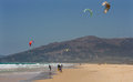 Sportsman kite surfer sportsmen surfers on clean beach in summer day tarifa spain Stock Photography