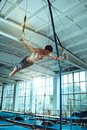 The sportsman during difficult exercise, sports gymnastics Royalty Free Stock Photo