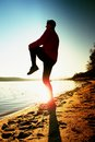 Sportsman  running at amazing summer sunset at the beach  in sport and healthy lifestyle concept Royalty Free Stock Photo