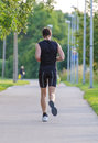 Sportsman running in park back view Royalty Free Stock Photography