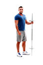 Sportsman standing with barbell full length portrait of a happy Stock Image