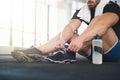Sportsman ties his sneakers black Royalty Free Stock Images