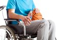 Sportsman on wheelchair a with a basketball and water a Royalty Free Stock Image