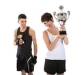 Sportsman and woman have won a trophy women over white background Stock Image