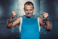 Sportsmen fit male stands and tear metal chain concept fitness workout strenght power Stock Photos