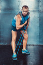 Sportsmen fit male trainer man doing exercises with expanders concept crossfit fitness workout strenght power Royalty Free Stock Image