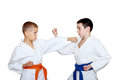 Sportsmen in kimono perform paired exercises athlete Stock Photography