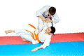 Sportsmens in judogi are training judo throws Royalty Free Stock Photo