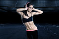 Sportswoman dancing with pink headphones Royalty Free Stock Images