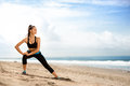 Sportswoman doing exercises on beach young beautiful Royalty Free Stock Photography