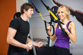 Sportswoman exercising with a resistance band at gym Stock Photos