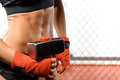 Sportswoman with a hummer in gym iron muscles close up of an ice and perfectly shaped female abs Stock Photos