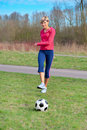 Sportswoman Kicking a Ball Royalty Free Stock Photo