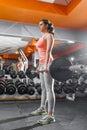 Sportswoman lifting hard barbell at gym Royalty Free Stock Photo