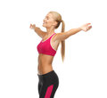 Sportswoman with raised up hands beautiful happy Royalty Free Stock Photo