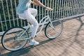 Sportswoman rides fast on a cruise bike around the city Royalty Free Stock Photo
