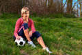 Sportswoman Sitting with a Ball Royalty Free Stock Photo