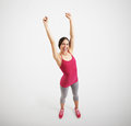 Sportswoman in sport wear view from above of happy raising her hands up and laughing over light grey background Royalty Free Stock Photos