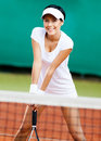 Sportswoman at the tennis court Royalty Free Stock Images