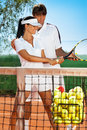 Sportswoman with tennis instructor young practicing Stock Images