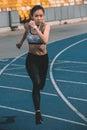 Sportswoman training on running track stadium, young girl running concept Royalty Free Stock Photo