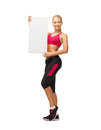 Sportswoman with white blank board happy smiling Royalty Free Stock Images