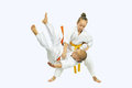 Sportswoman with a yellow belt is makes throw Judo Royalty Free Stock Photo