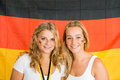 Sportswomen standing against german flag portrait of beautiful young Stock Images